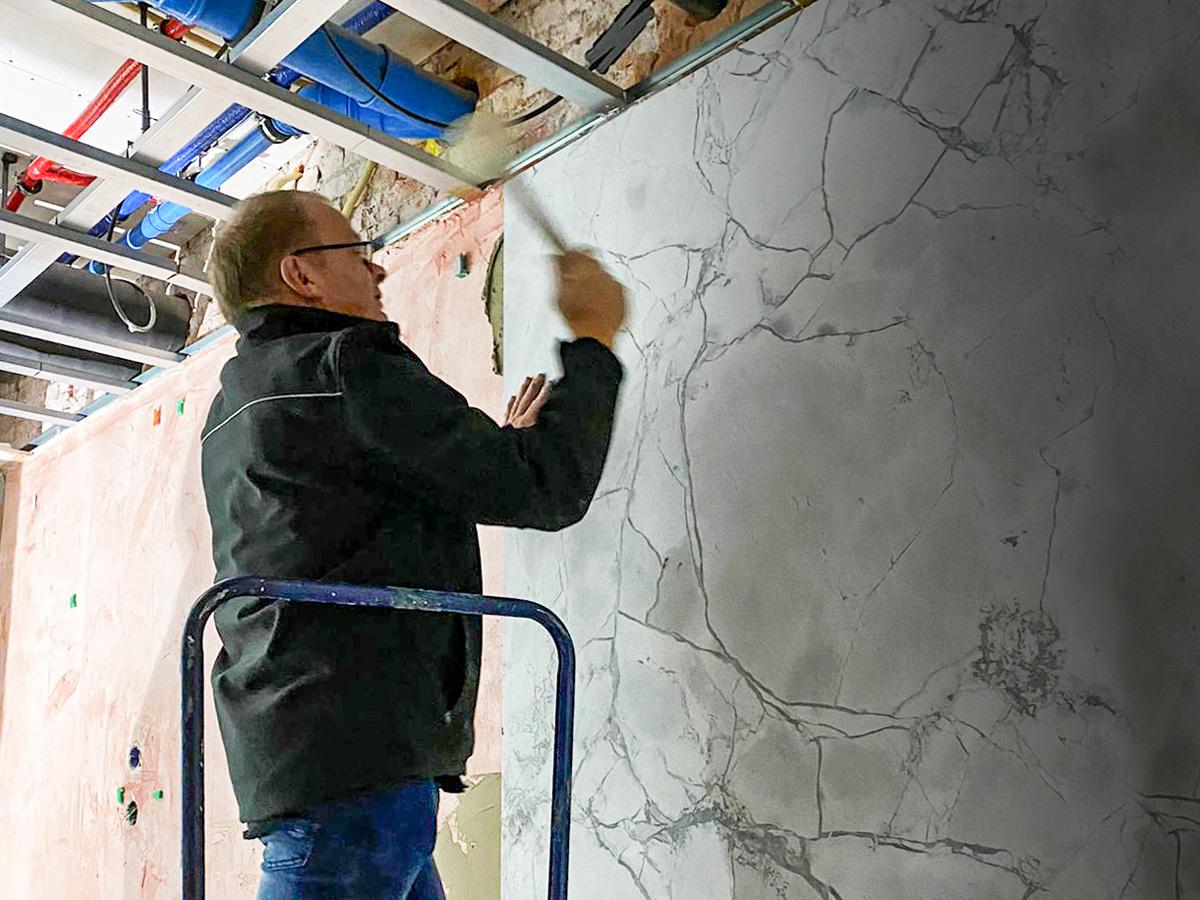 Berry van Nunen installing stone